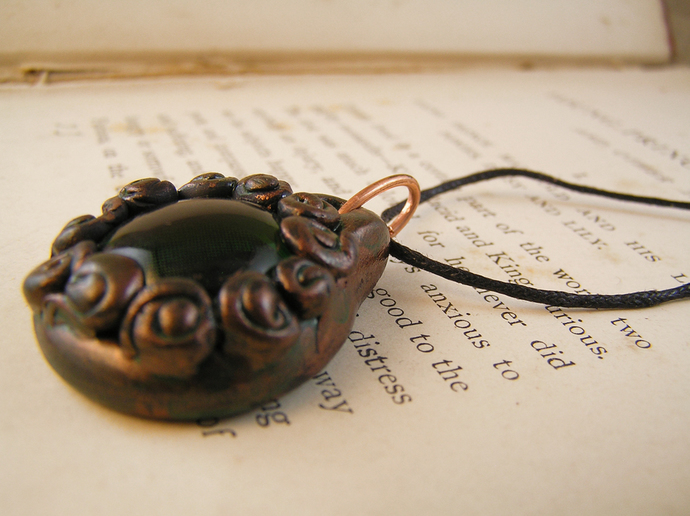 Copper and green steampunk cats eye pendant