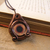 Orange and copper steampunk dragon eye pendant