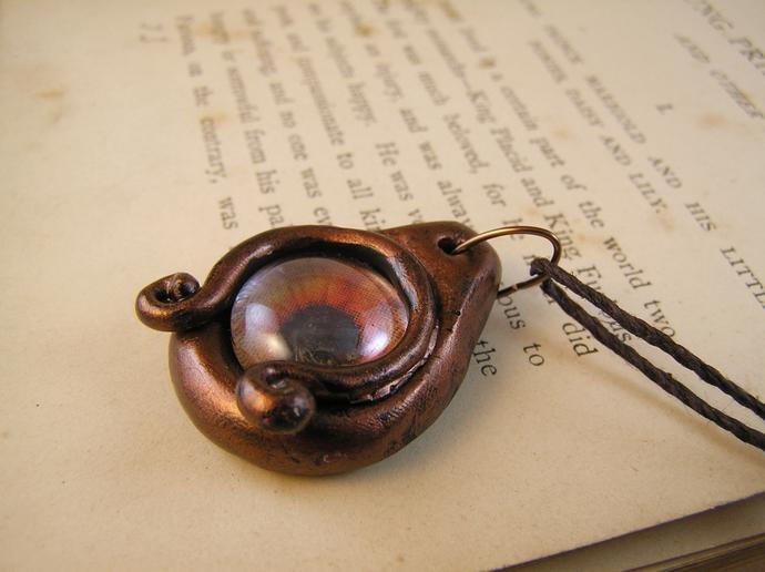 Orange and copper steampunk dragon eye pendant