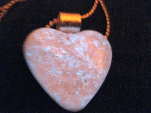 Luminescent  neutral colored heart shaped necklace