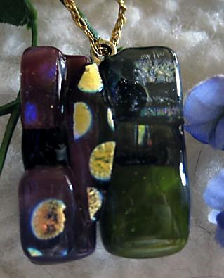 necklace of fused glass in cranberry,green and dichro