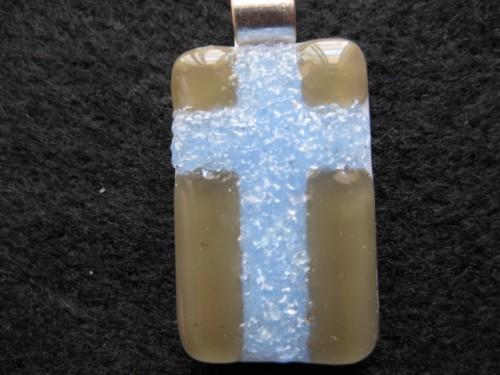 Cross pendant  illuminates in the dark