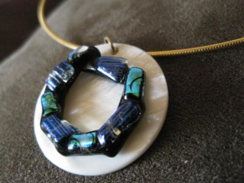 necklace of dichro ring  on mother of pearl