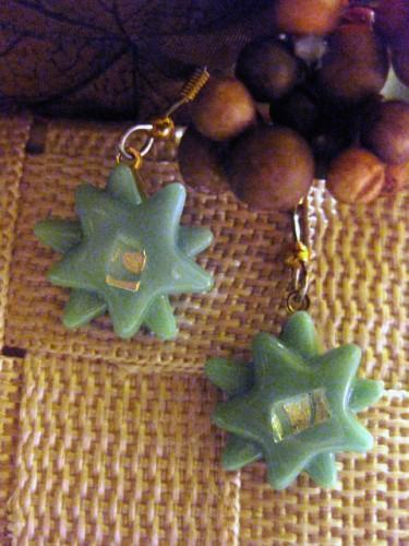 Light green star burst earrings with dichro center