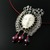 Wire knit Queen pendant with carved bone face and crystals