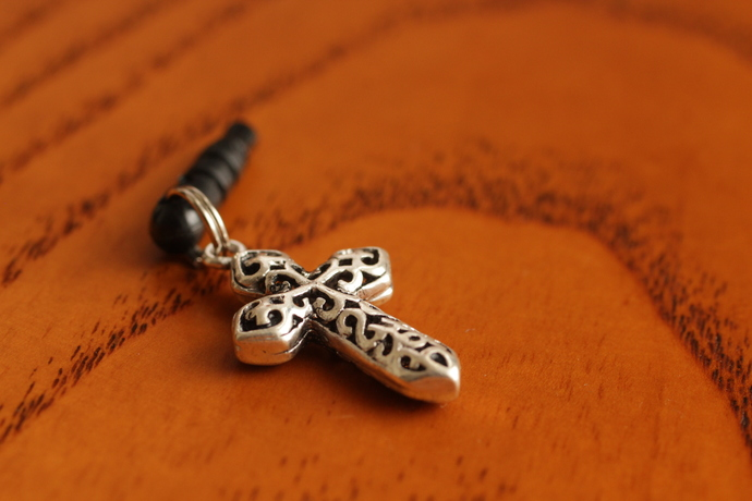 Cell phone charm with antiqued cross