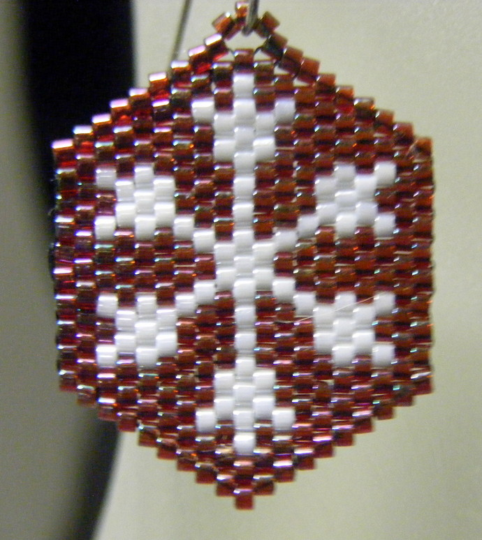 Snowflake On Garnet Background