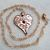 Gold Heart Pendant with Cubic Zirconia Accent on a Heart-link Necklace