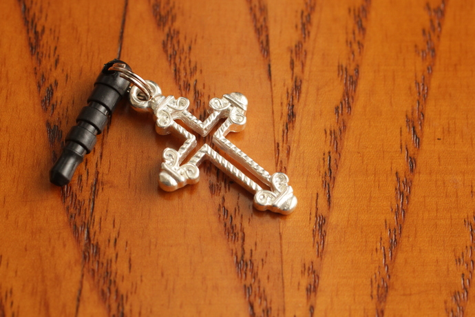 Cell phone charm with bright cross with scrollwork