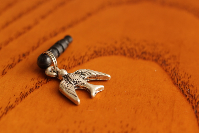 Cell phone charm with antiqued swallow
