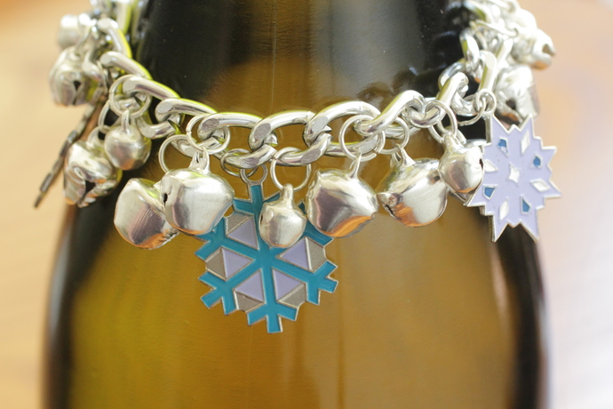 Silver snowflake bracelet with bells - 7 inches long