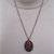 Copper necklace made with red agate, green seed beads in a copper bezel, red