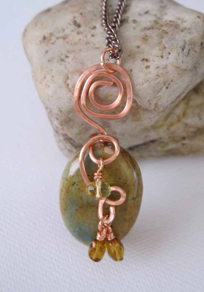 Copper necklace made with brown and teal bead with copper spirals and crystal