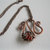 Copper swirl necklace with wire wrapped red glass bead, copper necklace, metal