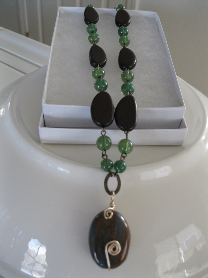 Large brown bead necklace with chocolate wood beads and green glass beads, green