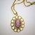Plum and Pink Skull and Crossbones Cameo in Goldtone Setting
