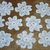 10 White Crocheted/Tatted 7 Petal Doilies #D-0006