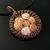 Copper wire knit pendant with tiny caged shells
