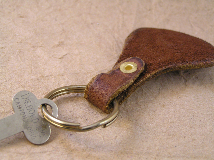 Wood burned leather bicycling keychain