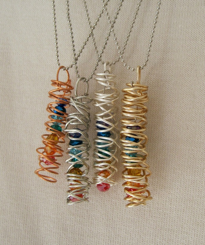Coiled wire jewelry ,copper, silver plated, gold and antiqued silver wire