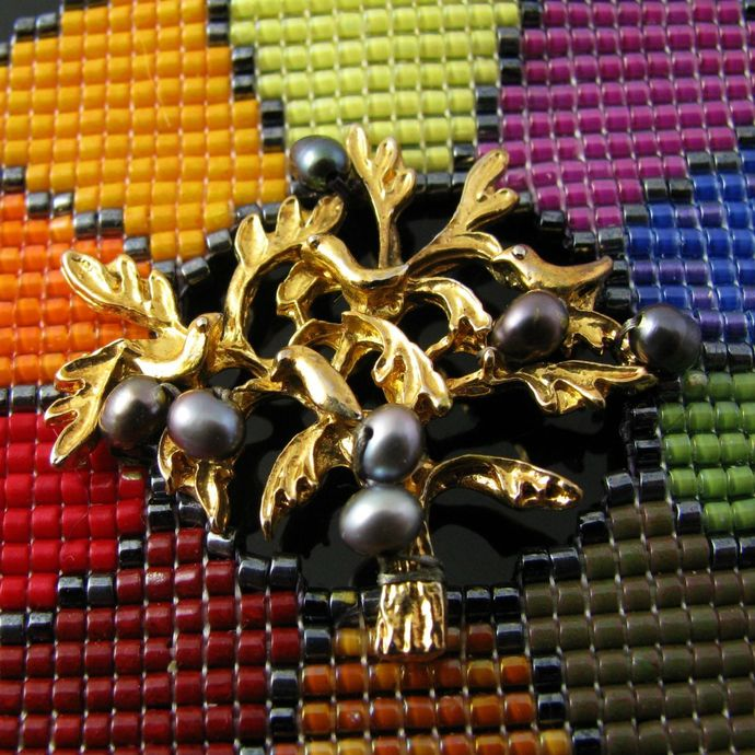 Bead loomed color wheel pendant with gold tone tree and pearls