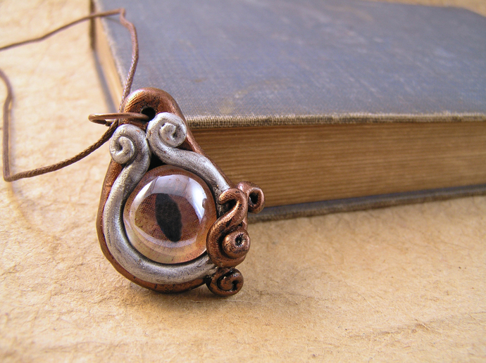 Amber, copper, and silver steampunk cats eye pendant