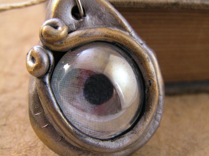 Silver and gold dragon eye steampunk pendant