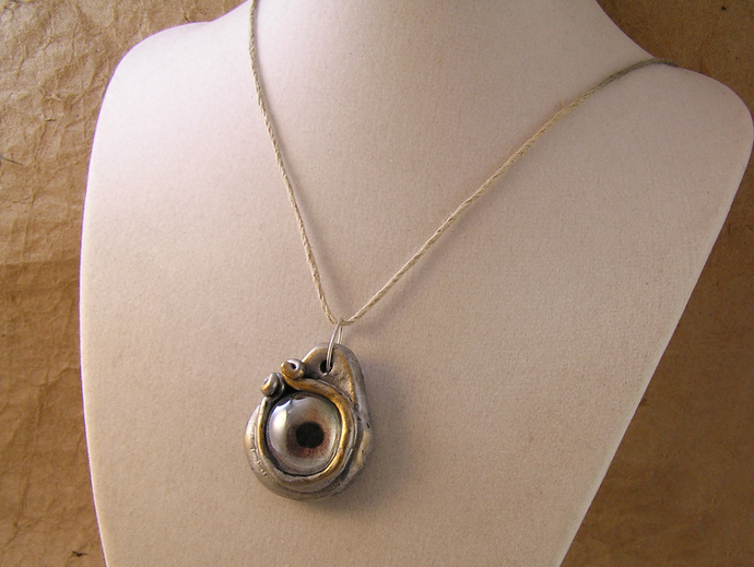 Silver and gold dragon eye steampunk pendant