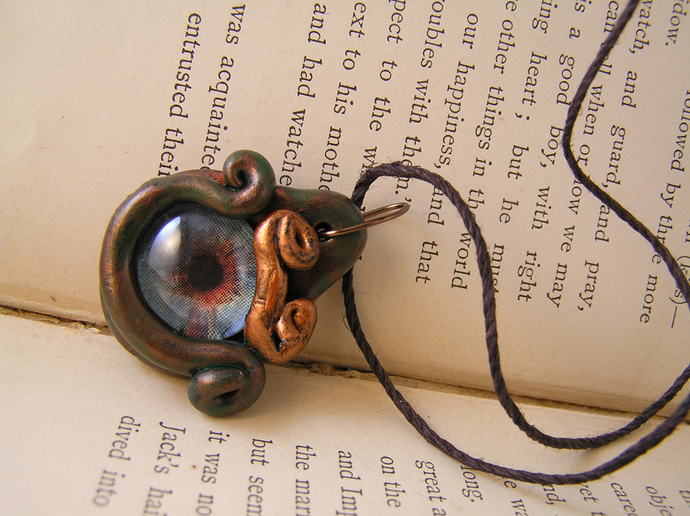 Blue and red dragon eye steampunk pendant with verdigris and copper surround
