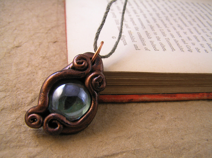 Light green and copper steampunk cats eye pendant