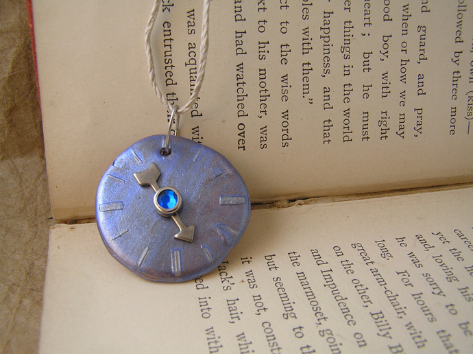 Metallic blue and silver steampunk watchface pendant with blue gem center