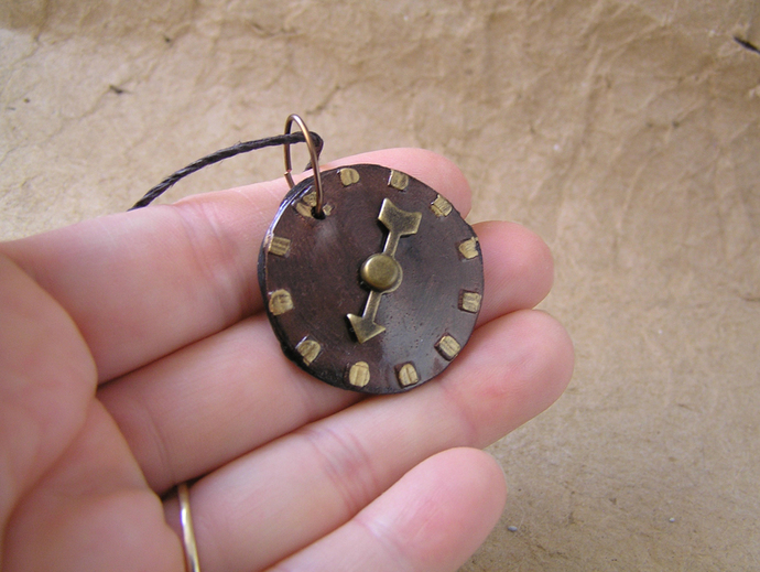 Metallic copper and gold steampunk watchface pendant with bronze pointer