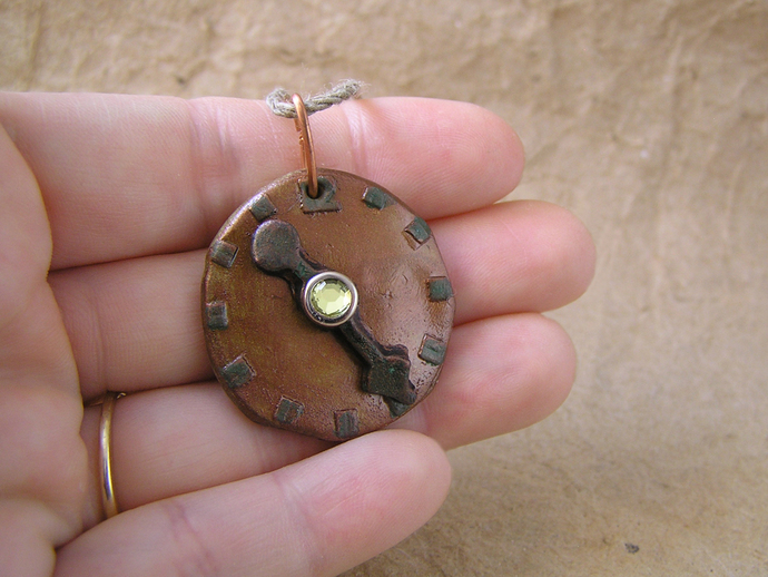 Steampunk watchface pendant in copper and bronze with yellow gem center