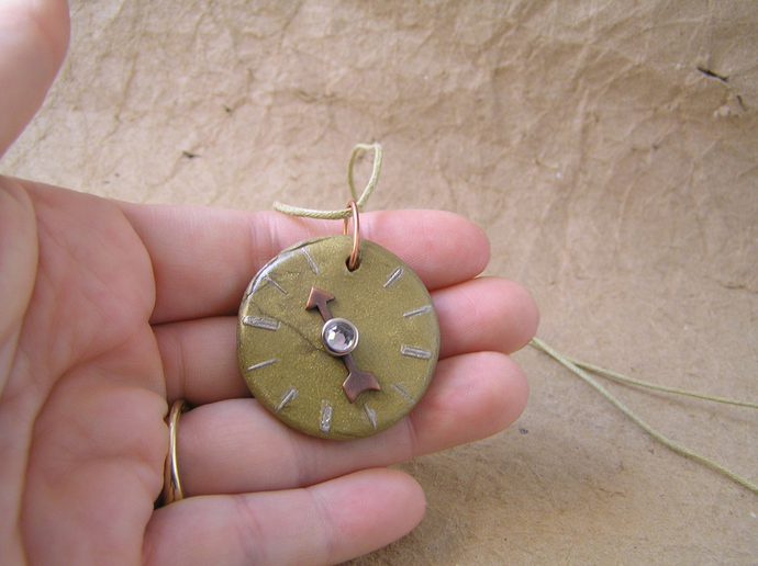 Steampunk watchface pendant in copper and gold with white gem center