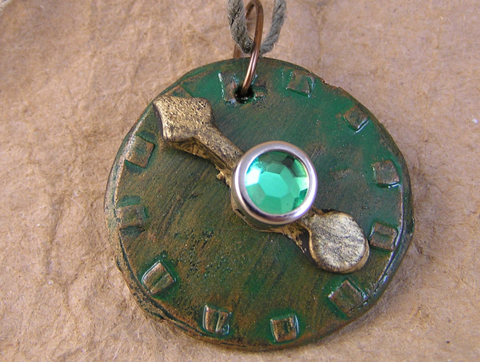 Steampunk watchface pendant in verdigris copper and gold with green gem center