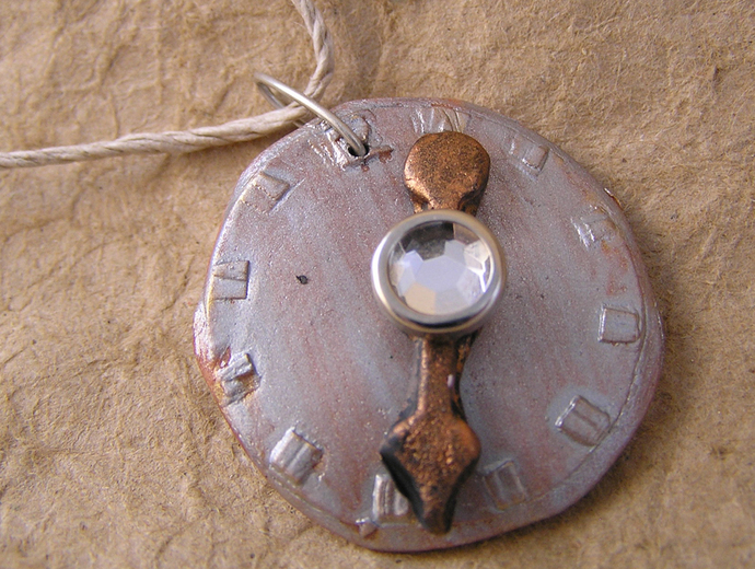 Steampunk watchface pendant in silver and copper with white gem center