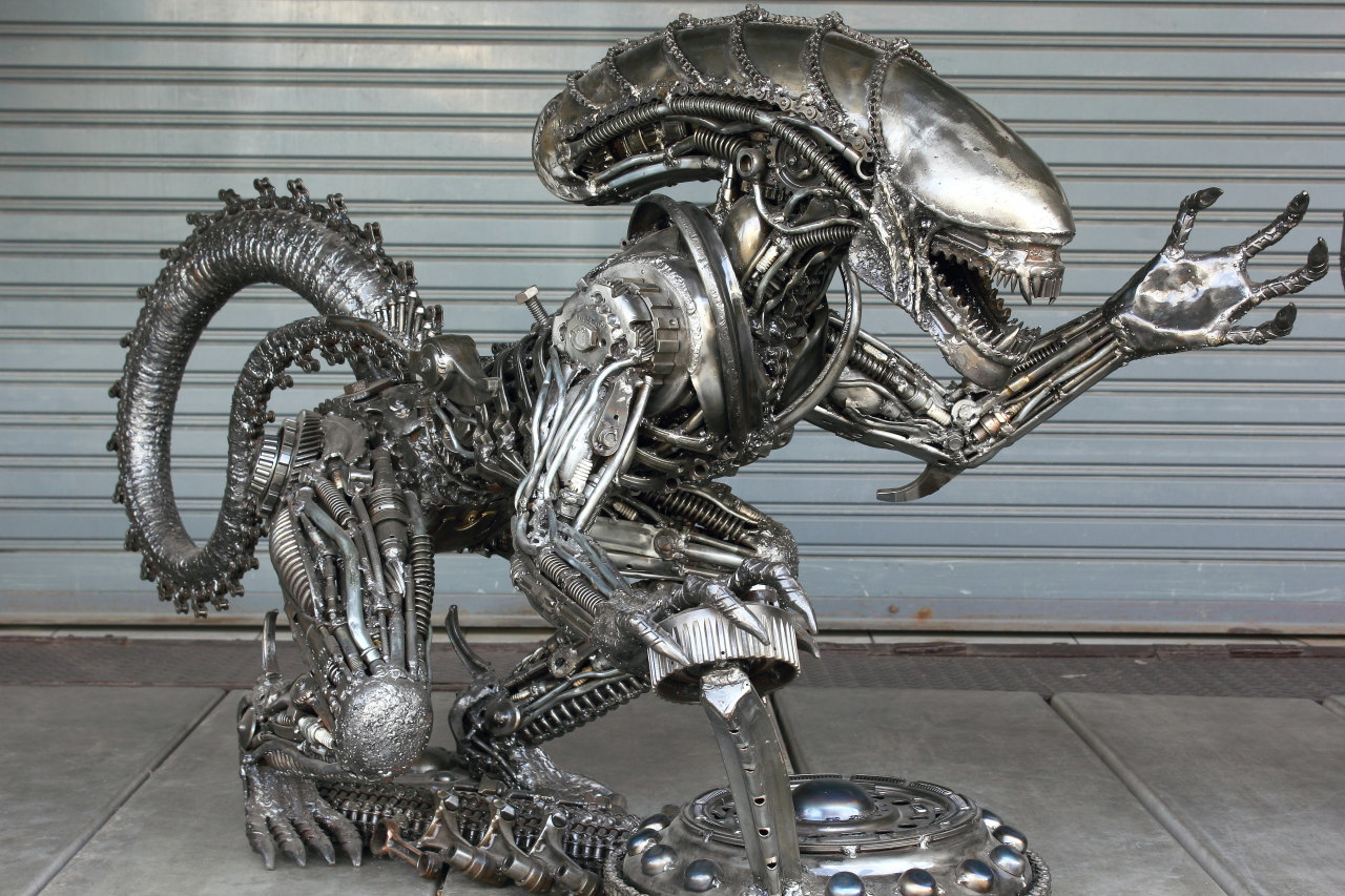 Large alien metal sculpture table by