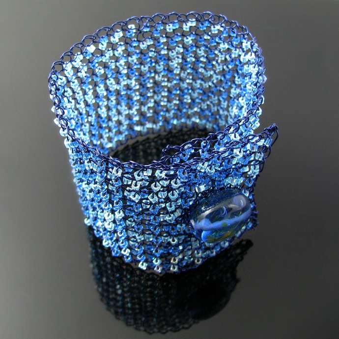 Wire knit bracelet with blue glass cubes and lampwork button