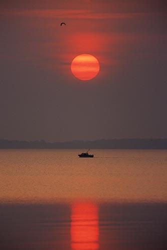 Lone Fishing Boat at Sunrise on Lake Erie